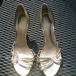 Aldo gently worn gold size 38 high heel shoes.